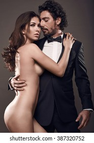 Suit man with woman naked